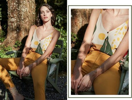 Calça cropped color amarela e regata de tiras com detalhe de mini botões na frente e estampa maxi floral.