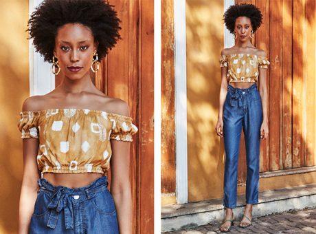 Blusa cropped ciganinha amarela com estampa geométrica off white, calça clochard jeans escuro.