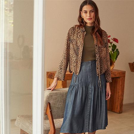 Looks com saia jeans midi: 11 opções para se inspirar